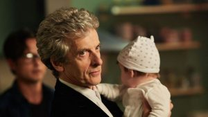 peter-capaldi-with-a-baby-christmas-mysterio-doctor-who